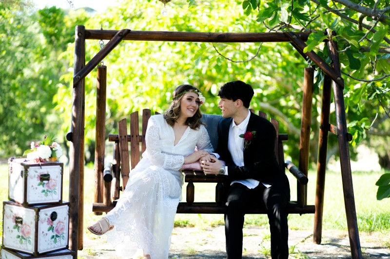 Just married couple taking a picture in the wooden swing - wedding planner siena