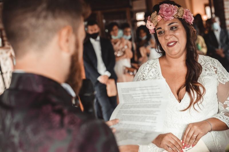Wedding ceremony - groom reads his promises to bride