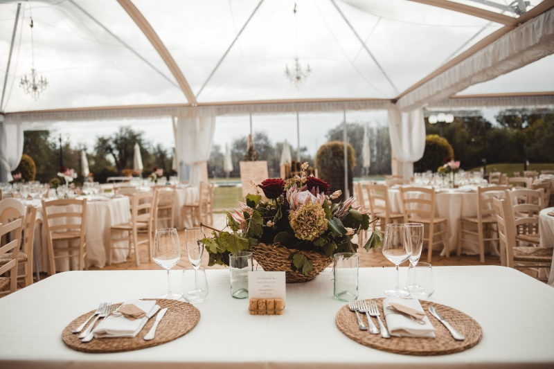 Wine wedding with rustic touches and protea as centerpiece