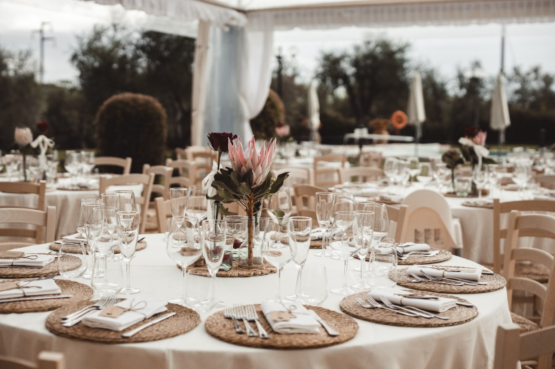 Wine wedding with rustic design and protea as centerpiece