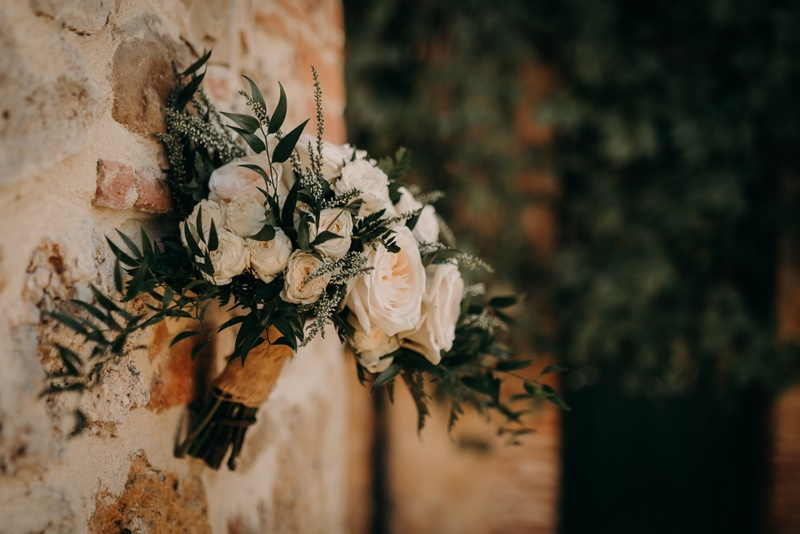 Bridal bouquet with white heathers, ruscus and dusty pink roses