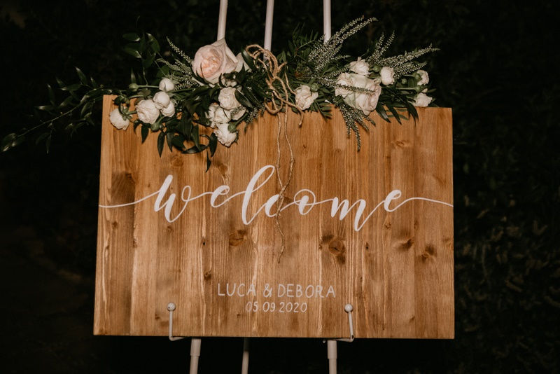 Rustic wooden welcome board sign